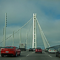 Vehicles rush across the Bay Bridge between Oakland and San Francisco, California.