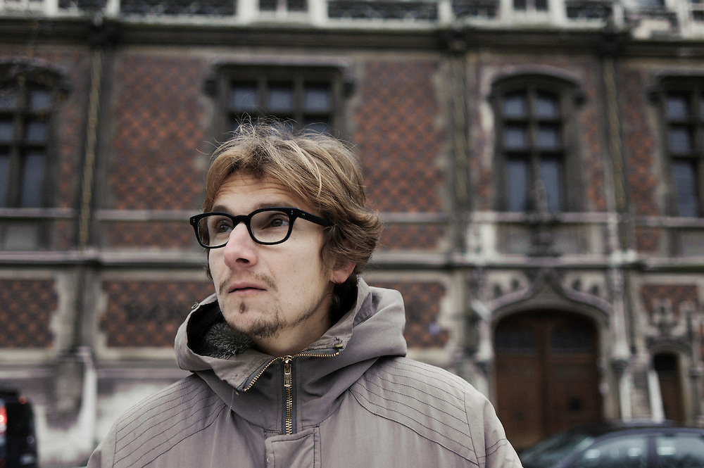 PARIS, FRANCE. NOVEMBER 22, 2010. French actor and writer Lorant Deutsch at the Parc Monceau, close to his home in the 17th arrondissement. Behind him stands the gothic-styled Banque de France. (photo: Antoine Doyen)
