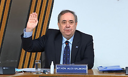 Edinburgh, Scotland, UK. 26 Feb 2021. Live streaming screenshot of Alex Salmond taking the oath at committee on the Scottish government handling of harassment complaints today at Scottish Parliament in Holyrood , Edinburgh. Iain Masterton/Alamy Live News