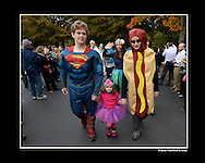 Atlanta: Drew Andersen, Superman, Mary Sandford,  Birdsey ,4, and Grayson Adams, hotdog, march in Holy Innocents' Episcopal School's annual Halloween Parade Thursday, October 31, 2013. One hundred fifteen seniors held the hands of 100 primary school kids  as they marched in front of students, teachers, parents and friends.  This year was the 45th year for the parade at the school founded in 1959.  © 2013 Johnny Crawford