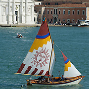 """VENICE, ITALY - JUNE 12:  A """"vela al terzo"""" boat sails in St Mark's basing ahead of the Regatta of the Ancient Maritime Republics on June 12, 2011 in Venice, Italy. The idea of the Regatta of the Ancient Maritime Republics was realized in 1955 and the first edition took place in Genova."""