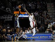 Ben Wallace tries to block a shot by Memphis' Hakim Warrick.