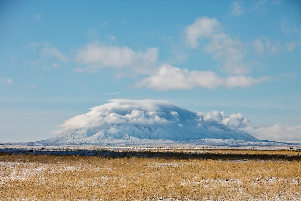 Open Edition Prints<br /> Big Butte in the Southeast Idaho desert creates its own weather pattern and cloud cover on a cold winter's morning
