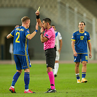 ATHENS, GREECE - OCTOBER 14: Florent Hadergjonajof Kosovo is shown a yellow card during the UEFA Nations League group stage match between Greece and Kosovo at OACA Spyros Louis on October 14, 2020 in Athens, Greece. (Photo by MB Media)