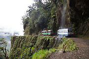 Bus van support vehicle driving for mountain bikers on 'the World's most dangerous road' down to Coroico in the Yungas, La Paz province, Bolivia.