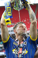 Jake Reeves midfielder for AFC Wimbledon (8) pours champagne from the trophy as AFC Wimbledon seal promotion to League One, after beating Plymouth Argyle Football Club 2-0 during the Sky Bet League 2 play off final match between AFC Wimbledon and Plymouth Argyle at Wembley Stadium, London, England on 30 May 2016. Photo by Stuart Butcher.