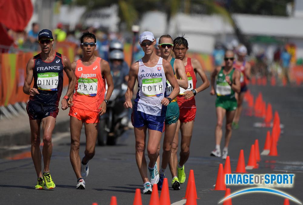 Aug 19, 2016; Rio de Janeiro, Brazil; Matej Toth (SVK) defeats Yohann Diniz (FRA), Hiroki Arai (JPN), Jared Tallent (AUS) and Wei Yu (CHN) to win the 50km race walk in 3:40:58 during the Rio 2016 Summer Olympic Games at Pontal.