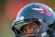 A boy looks on during football practice for Truth, an organization run by Deion Sanders, at the Prime Prep Academy campus in Dallas, Texas on August 6, 2014.