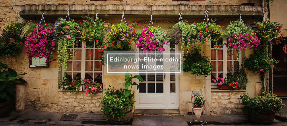 Hanging baskets of flowers outside a restaurant in Duras, Lot et Garonne, Aquitaine, France<br /> <br /> (c) Andrew Wilson | Edinburgh Elite media