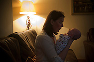 Kathryn Jones holding her nine-week-old son Finn, at their home in Canterbury, Kent. Finn was born to parents Philip and Kathryn at Evelina London Children's Hospital with a pre-diagnosed condition which required a life-saving, five-hour heart 'switch' operation to be carried out within the first two weeks of his life. The operation, which took place when Finn was 10 days old was successful, however, due to other near fatal complications the his recovery during the subsequent six weeks was slow and difficult.