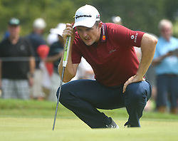 August 12, 2018 - St. Louis, Missouri, U.S. - ST. LOUIS, MO - AUGUST 12: Justin Rose lines up his putt on the #1 green during the final round of the PGA Championship on August 12, 2018, at Bellerive Country Club, St. Louis, MO.  (Photo by Keith Gillett/Icon Sportswire) (Credit Image: © Keith Gillett/Icon SMI via ZUMA Press)