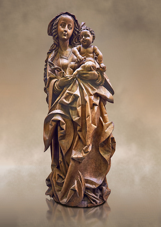 """Wooden Gothic sculpture of the Virgin and Child attributeed to Martin Hoffman from the city of Basle, 1507, Switzerland. From the Commandry of Isenheim, Haut Rhin. This sculpture is probably the """"big and ancient wooden statue of the Virgin"""" cited in 1793 in the inventory of the property of the Commandry of Isenheim.  The vervatious deep folds in the Virgins dress, the laughing child Jesus  and the style of Mary were repeatedly imitated in Basel at the beginning of the sixteenth century. This masterpiece of the German late Gothic sculpture was executed in a Basel workshop and can be attributed to Martin Hoffman. Expressive and enigmatic, the style of this masterpiece is the heir of the sculpture schools of Stragbourg and Veit Stoss Franconian art.  Inv RF 1833 The Louvre Museum, Paris. .<br /> <br /> If you prefer you can also buy from our ALAMY PHOTO LIBRARY  Collection visit : https://www.alamy.com/portfolio/paul-williams-funkystock/gothic-art-antiquities.html  Type -   louvre     - into the LOWER SEARCH WITHIN GALLERY box. Refine search by adding background colour, place, museum etc<br /> <br /> Visit our MEDIEVAL ART PHOTO COLLECTIONS for more   photos  to download or buy as prints https://funkystock.photoshelter.com/gallery-collection/Medieval-Gothic-Art-Antiquities-Historic-Sites-Pictures-Images-of/C0000gZ8POl_DCqE"""