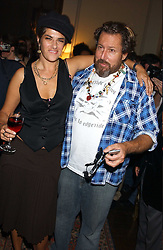 TRACEY EMIN and JULIAN SCHNABEL at a party to celebrate the publication of Strangeland by artist Tracey Emin at 33 Portland Place, London W1 ON 21ST OCTOBER 2005.<br />