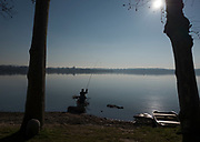 Erba. Lake Pusiano. Province of Coma ITALY. General View, Fishing in the Winter Sun, off the lake Shoreline <br /> <br /> Sunday  01/01/2017<br /> <br /> © Peter SPURRIER,<br /> <br /> <br /> LEICA CAMERA AG - LEICA Q (Typ 116) - 1/3200 - f5.6