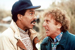GENE WILDER, (born Jerome Silberman, June 11, 1933 - August 28, 2016) was an American stage and screen comic actor, screenwriter, film director, and author. He was known best for the lead role in the 1971 film 'Willy Wonka in Willy Wonka & the Chocolate Factory,' and the Mel Brooks comedies 'Blazing Saddles', and 'Young Frankenstein', which Wilder co-wrote, garnering the pair an Academy Award nomination for Best Adapted Screenplay. Wilder died at age 83 from complications from Alzheimer's disease. PICTURED: RICHARD PRYOR and GENE WILDER in scene from the 1989 comedy 'See No Evil, Hear No Evil'. (Credit Image: © Courtesy of Tristar Pictures/Entertainment Pictures/ZUMAPRESS.com)