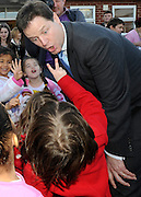© Licensed to London News Pictures. 27/01/2012, Solihull, UK. A child tells NICK CLEGG that he has eaten to cakes during the cake sale. NICK CLEGG  the British Deputy Prime Minister and Liberal Democrat leader is joined by Member of Parliament for Solihull LORLEY BURTat Peterbrook Primary School, Solihull, to see how the local primary school is using its Pupil Premium money. 27th January 2012.   Photo credit : Stephen Simpson/LNP