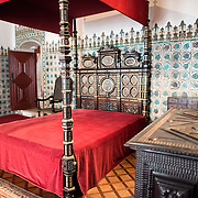 SINTRA, Portugal - Dating to the beginning of the 15th century, when it was known as the Gold Chamber, this was the bedchamber used by King Sebastian at the end of the 16th century. The tile wall consists of raised vine leaves and dates to the beginning of the 16th century. The Palace of Sintra (Palácio Nacional de Sintra) is a mediaeval royal palace in Sintra and part of the UNESCO World Heritage Site that encompasses several sites in and around Sintra, just outside Lisbon. The palace dates to at least the early 15th century and was at its peak during the 15th and 16th centuries. It remains one of the best-preserved royal residences in Portugal.