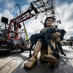 LIVERPOOL, UK, 20th April, 2012. The Sea Odyssey. A little girl giant and her dog sleep before a day searching Liverpool for her giant Uncle.