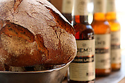 A loaf of Beer Bread with out of focus bottles of beer