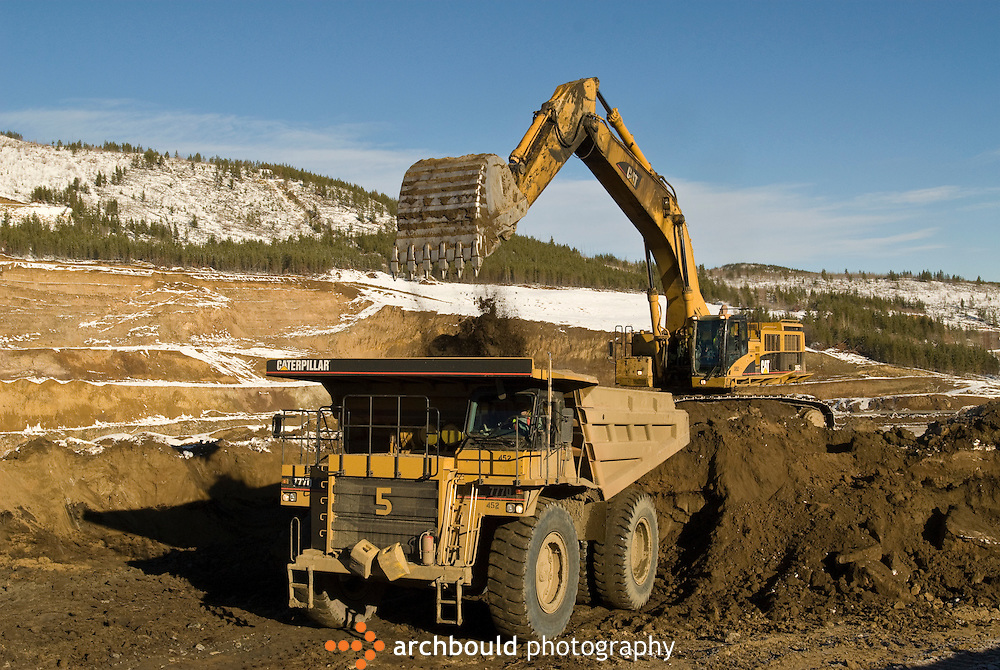 Heavy equipment working at Minto Mine, Yukon.