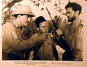 """Alexander """"Sasha"""" Siemel (right) holding his zagaya (spear) with Frank Buck (left) in promotional still for the movie """"Jungle Menace"""""""