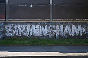 Old faded painted sign for Birmingham under Coronavirus lockdown on 5th May 2020 in Birmingham, England, United Kingdom. Coronavirus or Covid-19 is a new respiratory illness that has not previously been seen in humans. While much or Europe has been placed into lockdown, the UK government has put in place more stringent rules as part of their long term strategy, and in particular social distancing.