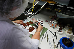 SOLMS, GERMANY - MAY-18-2009 - Technicians apply the finishing touches to a Leica camera body. (Photo © Jock Fistick)