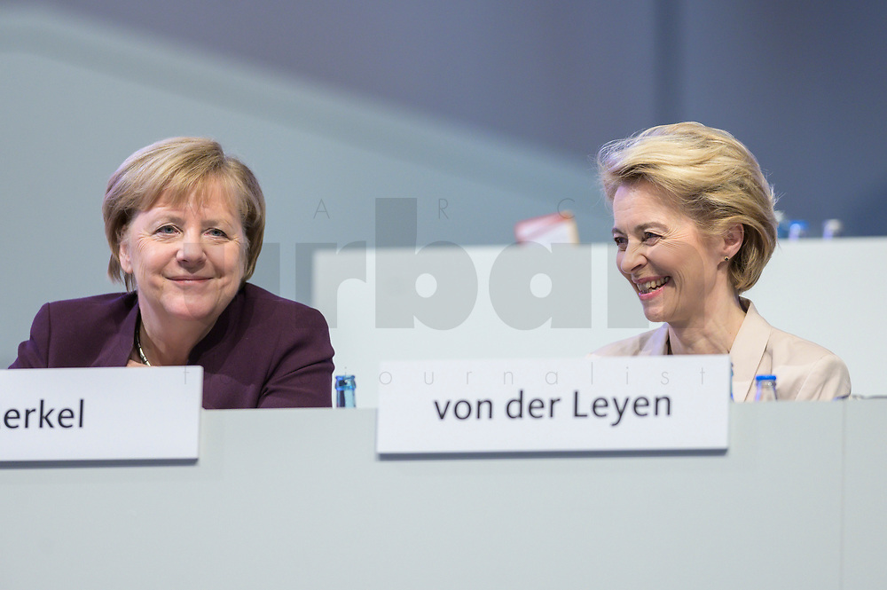22 NOV 2019, LEIPZIG/GERMANY:<br /> Angela Merkel (L), CDU, Bundeskanzlerin, und Ursula von der Leyen (R), CDU, gewaehlte Praesidentin der Europaeischen Kommission, im Gespraech, CDU Bundesparteitag, CCL Leipzig<br /> IMAGE: 20191122-01-050<br /> KEYWORDS: Parteitag, party congress, Gespräch, freundlich, lachten lacht