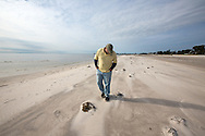 12/19/2015,  Long Beach, Mississippi, A biologist with the Mississippi Department of Environmental Quality surveying dead ducks during a fish kill event. Most of the ducks washed up are male  ducks from one species of diving ducks, the lesser scaup. A red tide ( toxic algae growth)  was blaimed for a fish kill event that also killed many ducks and some mammals along beaches in Mississippi along the Gulf of Mexico that started at the deginning of December and continued through the end of the month. Warming tempatures caused by climate change,  make 'red tide' conditions a growing problem on the Gulf Coast.