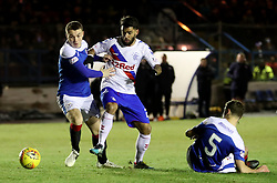 Cowdenbeath's Harvey Swann and Rangers' Daniel Candeias battle for the ball during the William Hill Scottish Cup fourth round match at Central Park, Cowdenbeath.