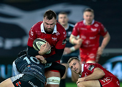 David Bulbring of Scarlets under pressure from Sam Davies of Ospreys<br /> <br /> Photographer Simon King/Replay Images<br /> <br /> Guinness PRO14 Round 11 - Ospreys v Scarlets - Saturday 22nd December 2018 - Liberty Stadium - Swansea<br /> <br /> World Copyright © Replay Images . All rights reserved. info@replayimages.co.uk - http://replayimages.co.uk