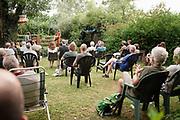 Nederland, Beuningen, 27-6-2020 Marike Jager gaf gisteren een corona-proof optreden in de tuin van het voormalig klooster waar ze woont. Vanwege de afgelasting van speelmogelijkheden zijn veel muzikanten en andere publieks-artiesten genoodzaakt op andere manieren hun ding te doen...Het was weliswaar voor maar 30 mensen, maar een goed uitgevoerd en gezellig concert. Foto: ANP/ Hollandse Hoogte/ Flip Franssen