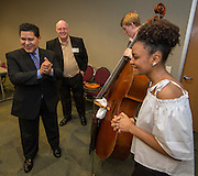 Houston ISD Superintendent Richard Carranza meets with members of the HSPVA Jazz Combo before a meeting to discuss partnerships with representatives from universities across the state, February 22, 2017.