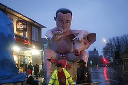 © Licensed to London News Pictures. 05/11/2015. Lewes, UK. A David Cameron effigy is being prepared for a bonfire parade in Lewes, Sussex during the traditional Bonfire Night celebrations on Thursday, 5 November, 2015. Thousands of people attend the parade through the narrow streets of Lewes and burn effigies to celebrate Guy Fawke night. Photo credit: Tolga Akmen/LNP