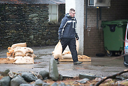 © Licensed to London News Pictures. 22/12/2015. Glenridding UK. The village of Glenridding that flooded twice in one week in the last round of bad weather is preparing for more floods after days of heavy rain. Photo credit: Andrew McCaren/LNP