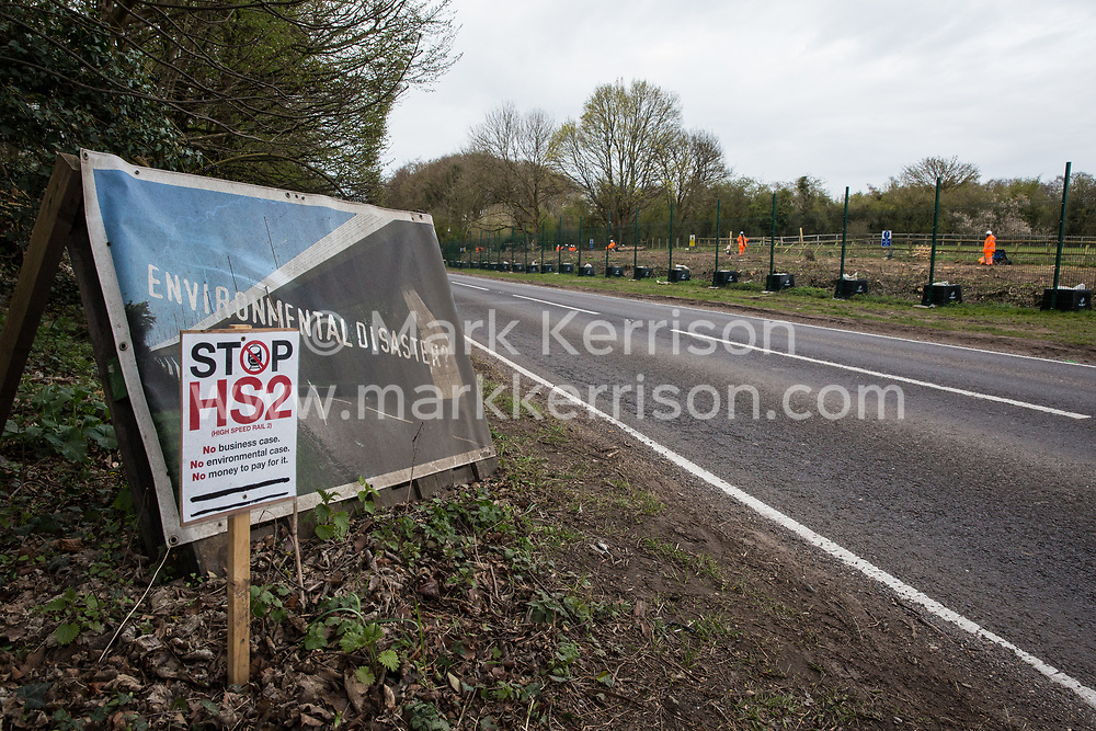 Wendover, UK. 9th April, 2021. Signs reading 'Environmental Disaster?' and 'Stop HS2' are pictured opposite a site currently being cleared of trees and vegetation by HS2 contractors on 9th April 2021 in Wendover, United Kingdom. Tree felling work for the project is now taking place at several locations between Great Missenden and Wendover in the Chilterns AONB, including at Jones Hill Wood.