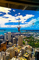 Jumper attached to a harness and cable about to be dropped from the Sky Jump atop the 328 meter high Sky Tower (the tallest free-standing structure in the Southern Hemisphere), Auckland, New Zealand