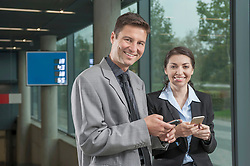 Two business executives sharing their contacts, Bavaria, Germany
