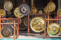 The gong village of Phibun Mangsahan, near the confluence of the Mekong and Mun Rivers at  Khong Chiam, is famous for its hand forged bronze gongs used in temples and Asian music ensembles.   This is a local cottage industry -  and one of the remaining few.  Visitors can view the artisans making these prized gongs - the process involves hammering metal disks and tempering them in fire. The gongs range from the simple to the detailed and decorated, and are available for purchase.