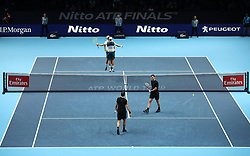 Mike an Bob Bryan react during their doubles match against Bruno Soares (bottom left) and Jamie Murray during day two of the NITTO ATP World Tour Finals at the O2 Arena, London.