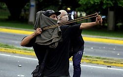 July 6, 2017 - Valencia, Carabobo, Venezuela - Several cities of the country maintain their protests against the president Nicolas Maduro, in the zone of the trigal, in Valencia, Carabobo state, they were faced again civil society, students against the state police. There were a dozen people injured and affected by the gases. Photo: Juan Carlos Hernandez (Credit Image: © Juan Carlos Hernandez via ZUMA Wire)