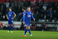 Jamie Vardy of Leicester city looks on dejected as Swansea city players celebrate after they score their 2nd goal . Premier league match, Swansea city v Leicester City at the Liberty Stadium in Swansea, South Wales on Sunday 12th February 2017.<br /> pic by Andrew Orchard, Andrew Orchard sports photography.