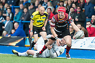 Tyler Morgan of the Newport Gwent Dragons manages to pass the ball as he is tackled by Rhys Patchell  of the Cardiff Blues. Guinness Pro12 rugby match, Cardiff Blues v Newport Gwent Dragons at the Cardiff Arms Park in Cardiff, South Wales on Sunday 17th April 2016.<br /> pic by Simon Latham, Andrew Orchard sports photography.