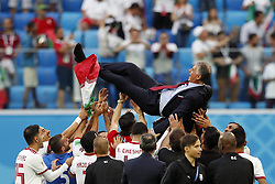coach Carlos Queiroz of IR Iran is is celebrated by his players