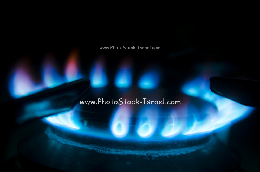 Blue flames in a gas ring on cooker