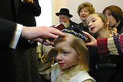 In Stamford Hill, London, United Kingdom, on the 3rd birthday of a Orthodox Jewish boy he has his first ever hair cut leaving his peyos (sideburns) to grow. His Grandfather then places a kippah on his head for the first ever time. A kippah is said to be 'A blessing on the head' and is perhaps the most instantly identifiable mark of a Jew. He will now begin to learn the Torah.
