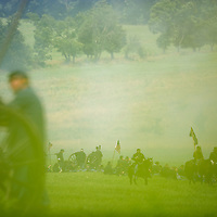 As cavalry patrols the front line, federal artillery fires upon the confederate lines during Pickett's Charge at the finale of the Blue Gray Alliance reenactment during events marking the 150th anniversary of the Battle of Gettysburg, in Gettysburg, Pennsylvania June 30, 2013.