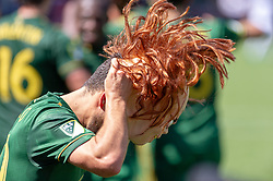 May 13, 2018 - Portland, OR, U.S. - PORTLAND, OR - MAY 13: Portland Timbers midfielder Sebastián Blanco puts on a ''Chucky'' mask of the popular horror film character of ''Childs Play'', also known as Blanco's nickname, after scoring the winning goal of the Portland Timbers 1-0 victory over the Seattle Sounders on May 13, 2018, at Providence Park in Portland, OR. (Photo by Diego Diaz/Icon Sportswire) (Credit Image: © Diego Diaz/Icon SMI via ZUMA Press)