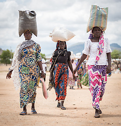 30 May 2019, Mokolo, Cameroon: On market day, women carry their goods home from the marketplace in Minawao. The Minawao camp for Nigerian refugees, located in the Far North region of Cameroon, hosts some 58,000 refugees from North East Nigeria. The refugees are supported by the Lutheran World Federation, together with a range of partners.