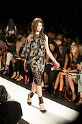 A black and beige dress with lace accents at the BCBGMAXAZRIA show at the Spring 2013 Mercedes Benz Fashion Week show in New York.